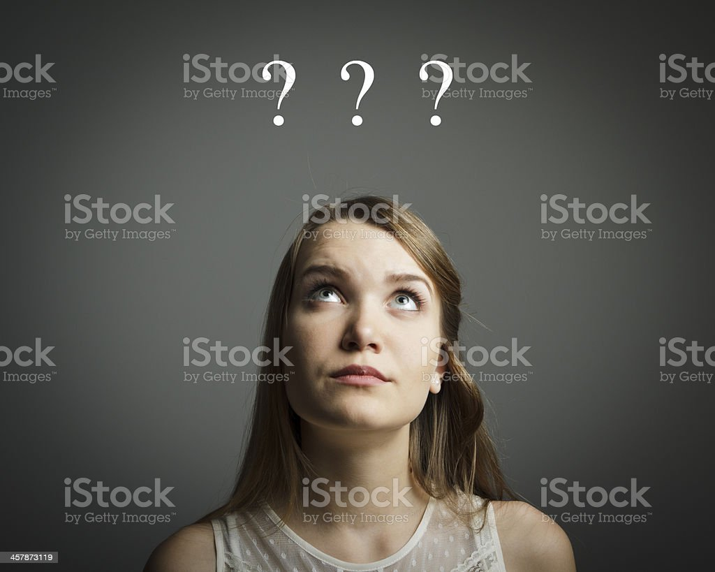 Girl in white and question marks royalty-free stock photo