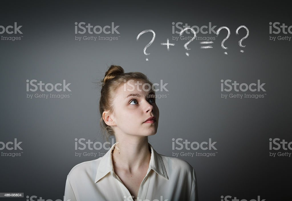 Girl in white and question marks stock photo