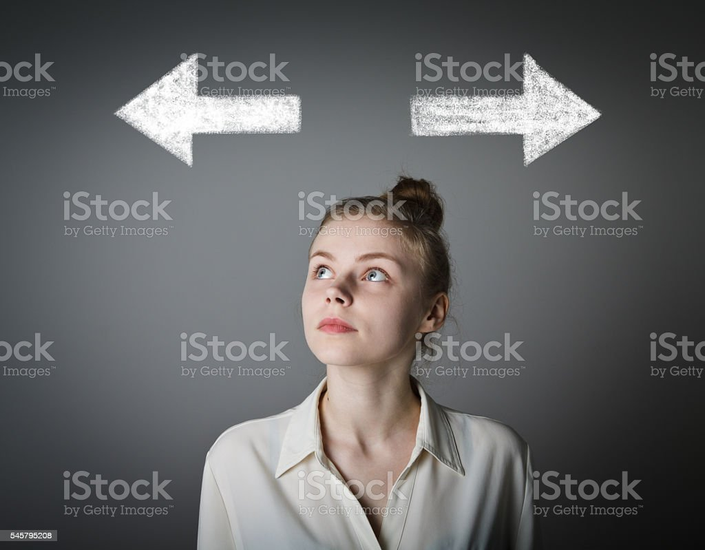 Girl in white and two arrows. stock photo