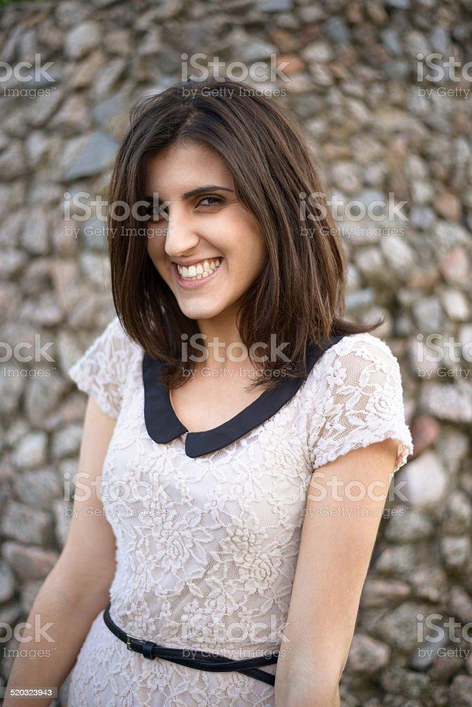 girl in white dress smiling stock photo
