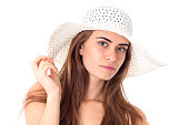 girl in white hat with wide brim