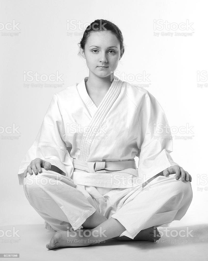 Girl in white kimono sitting traditionally royalty-free stock photo