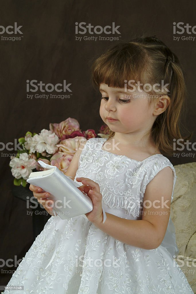 Girl in white with Bible royalty-free stock photo