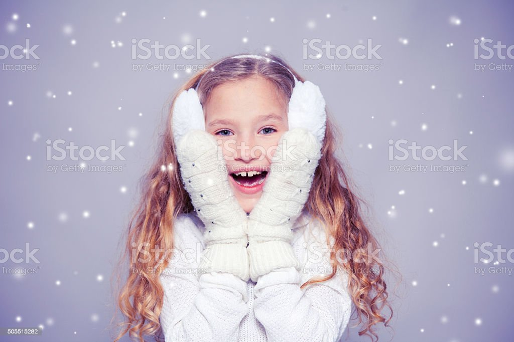Girl in winter clothes stock photo