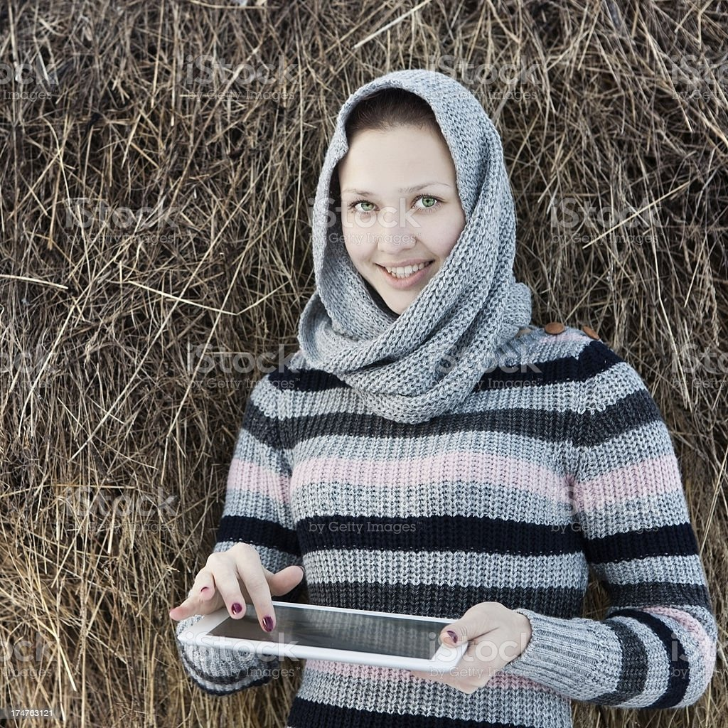 Girl in winter clothes with Digital Tablet royalty-free stock photo