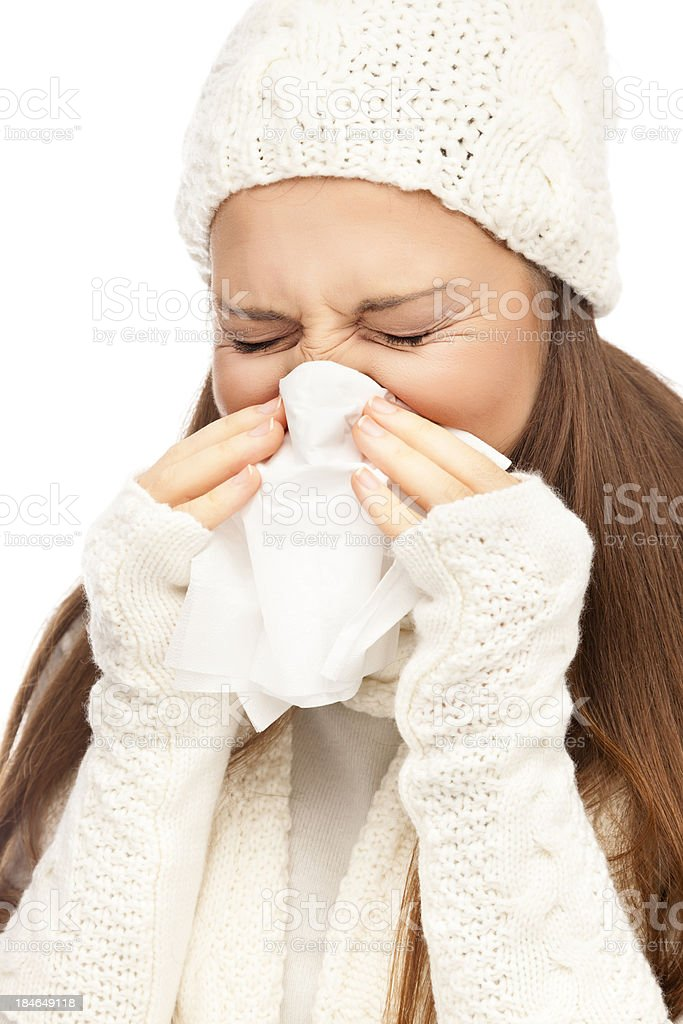 Girl in winter clothing sneezing royalty-free stock photo