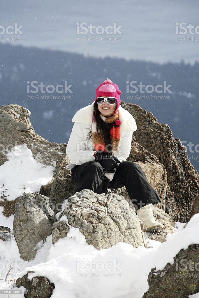 Girl in winter mountains royalty-free stock photo