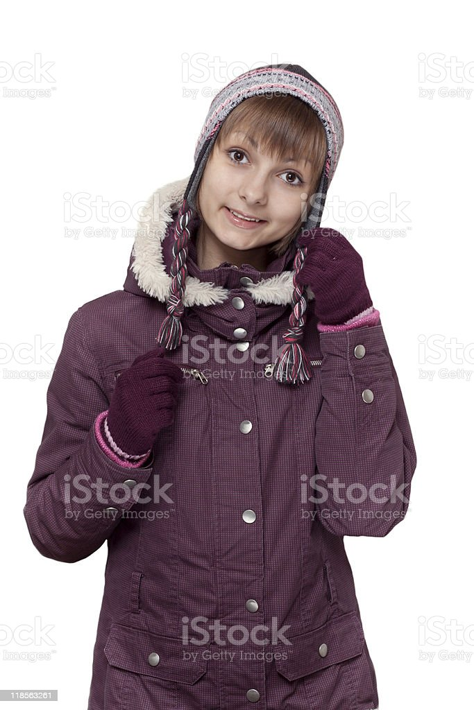 Girl in winter violet hooded jacket with hat stock photo