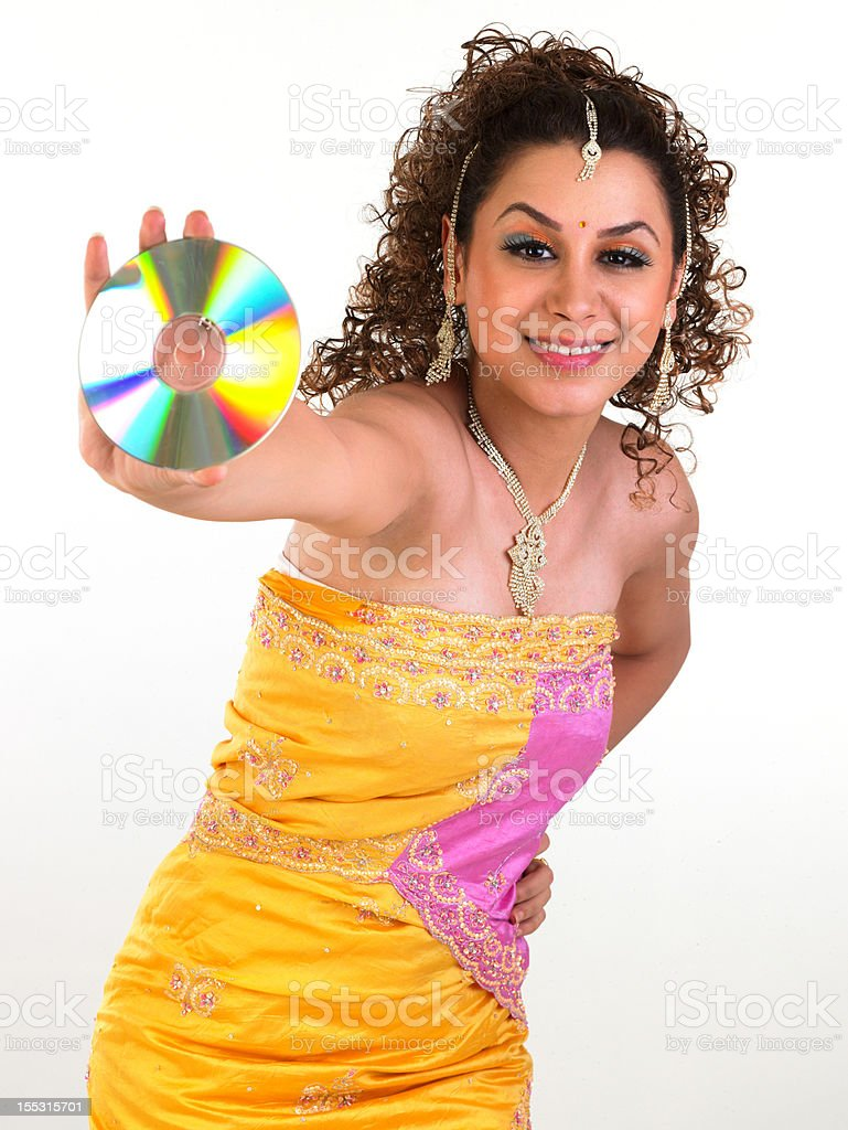 girl in yellow costume holding CD royalty-free stock photo