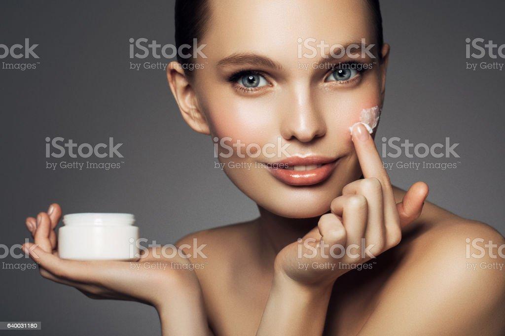 Girl inflicting cream stock photo