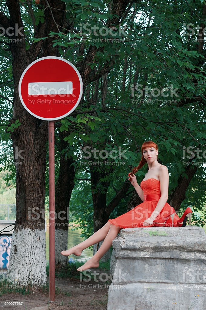 Girl inred dress stock photo