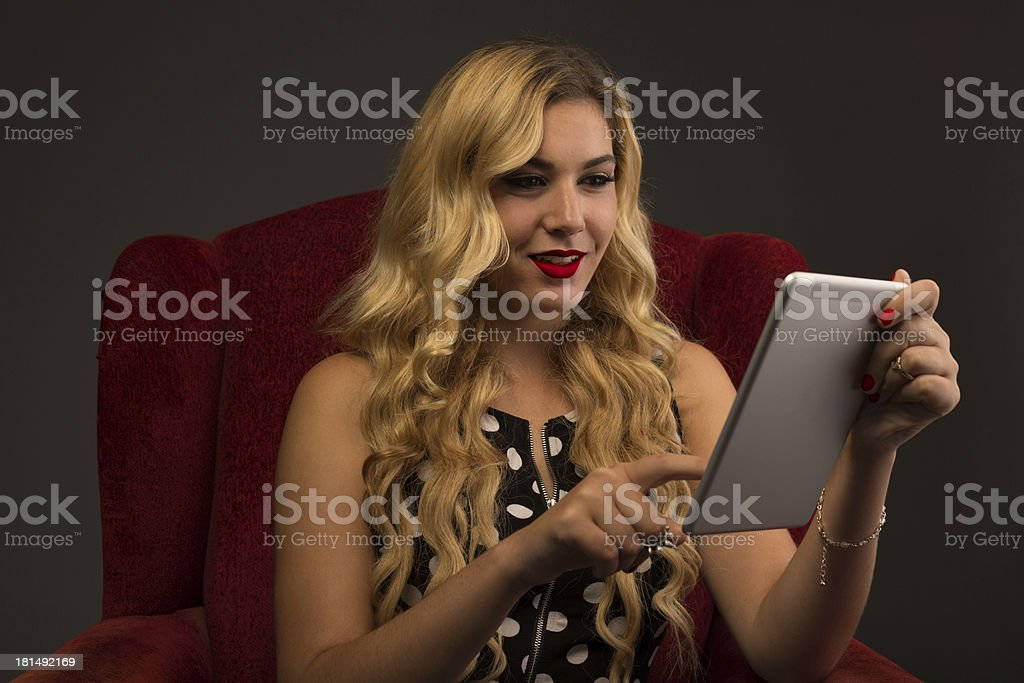 Girl Interacting with Tablet royalty-free stock photo