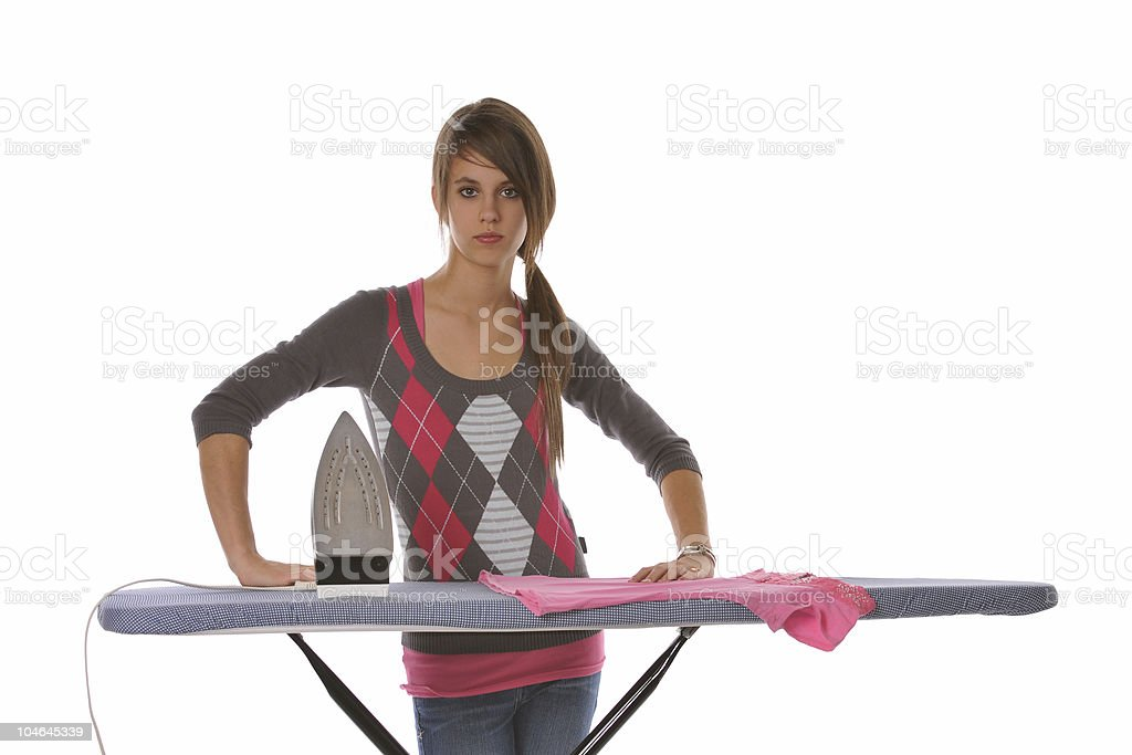 Girl ironing her clothes royalty-free stock photo