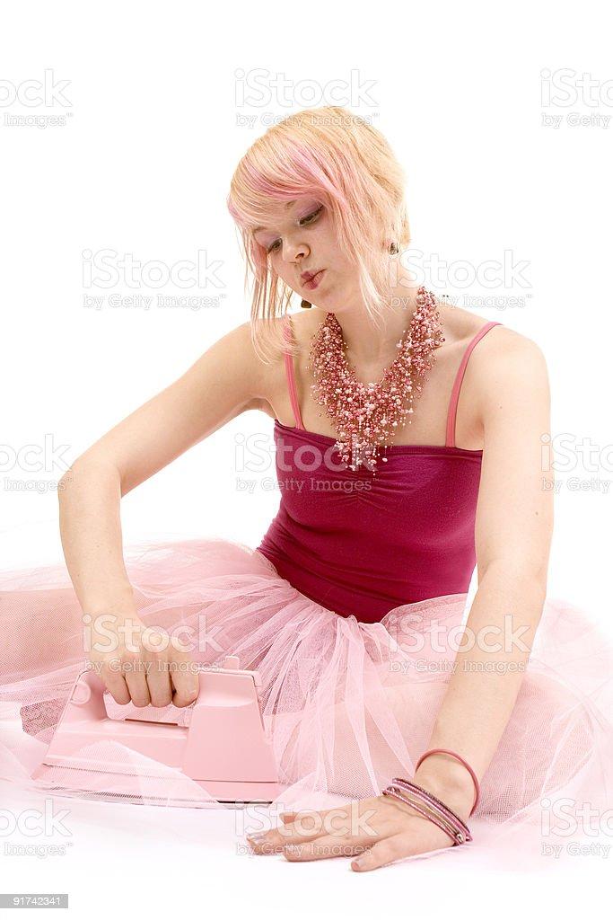 girl ironing tutu stock photo