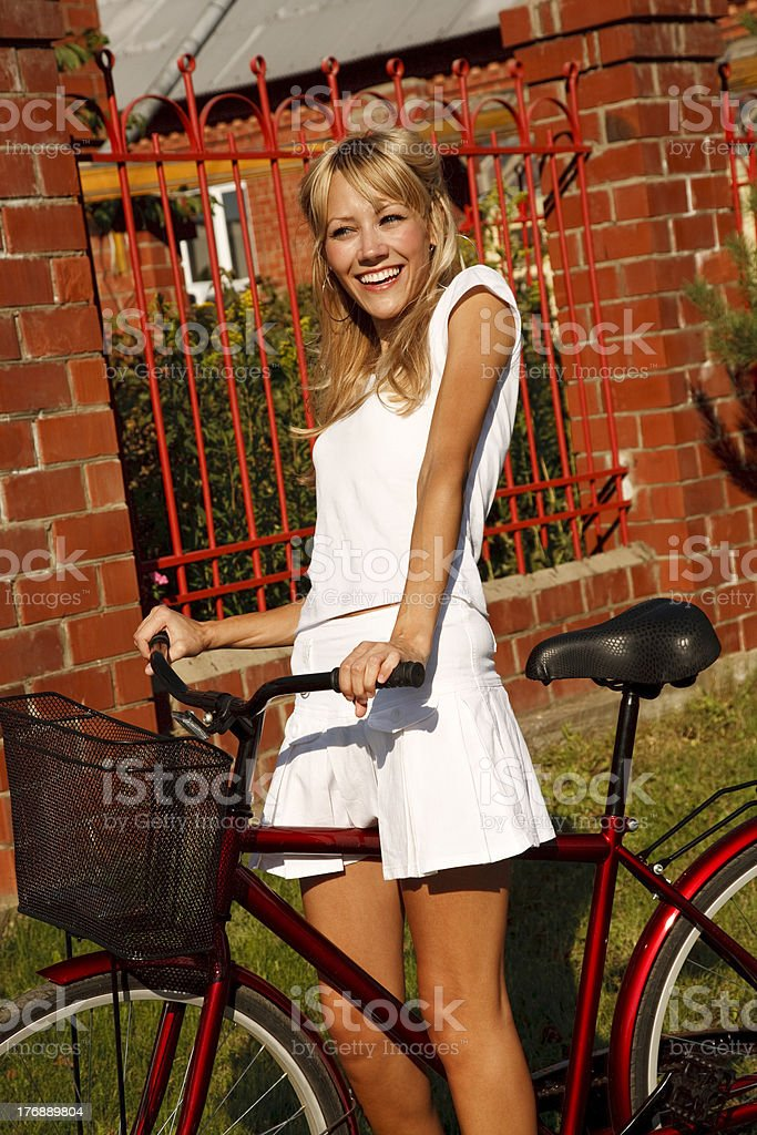 Girl  is cycling in suburb royalty-free stock photo