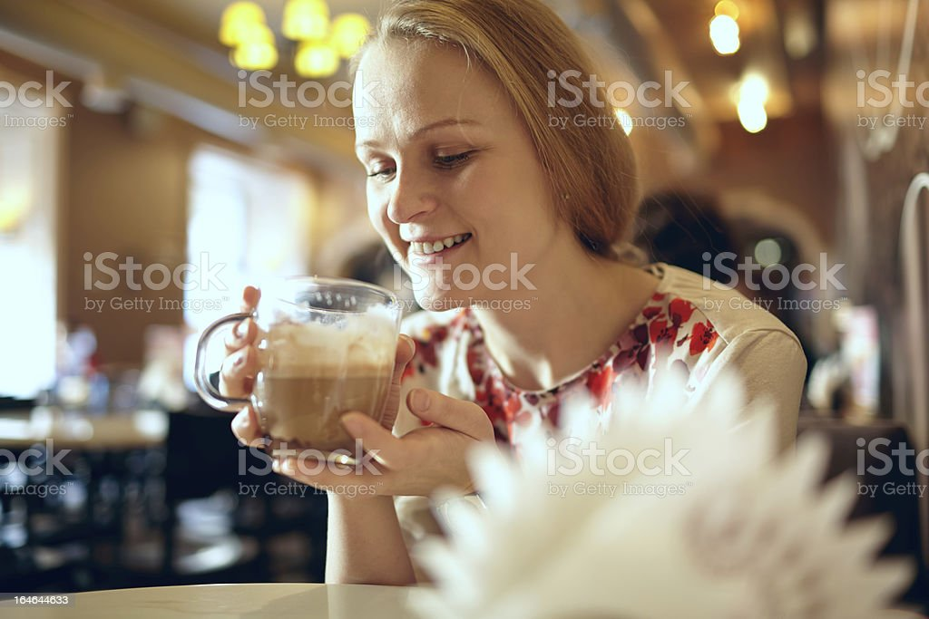 Girl is drinking latte in cafe. royalty-free stock photo