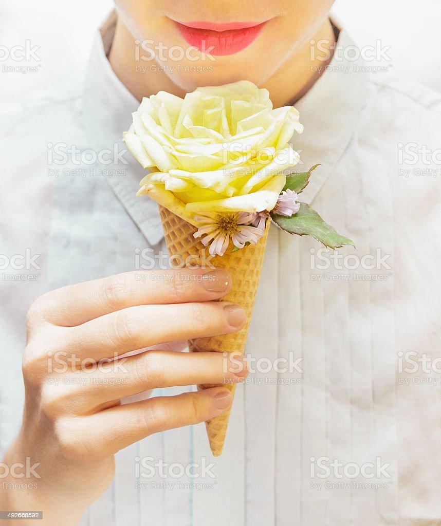 Girl is eating an unusual ice cream stock photo