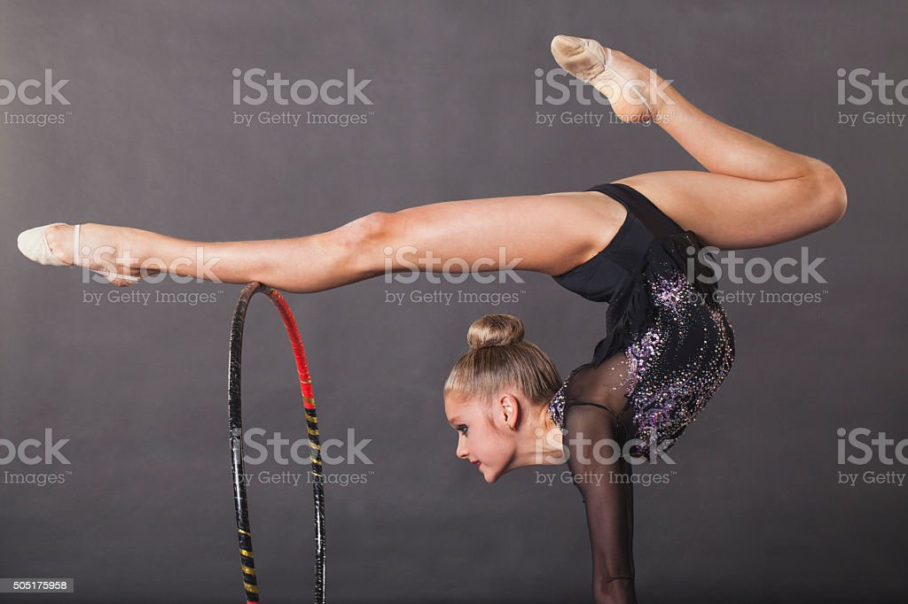 Girl is engaged in rhythmic gymnastics stock photo