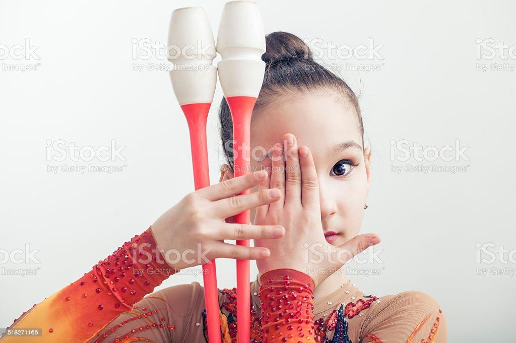 Girl is engaged in rhythmic gymnastics stock photo