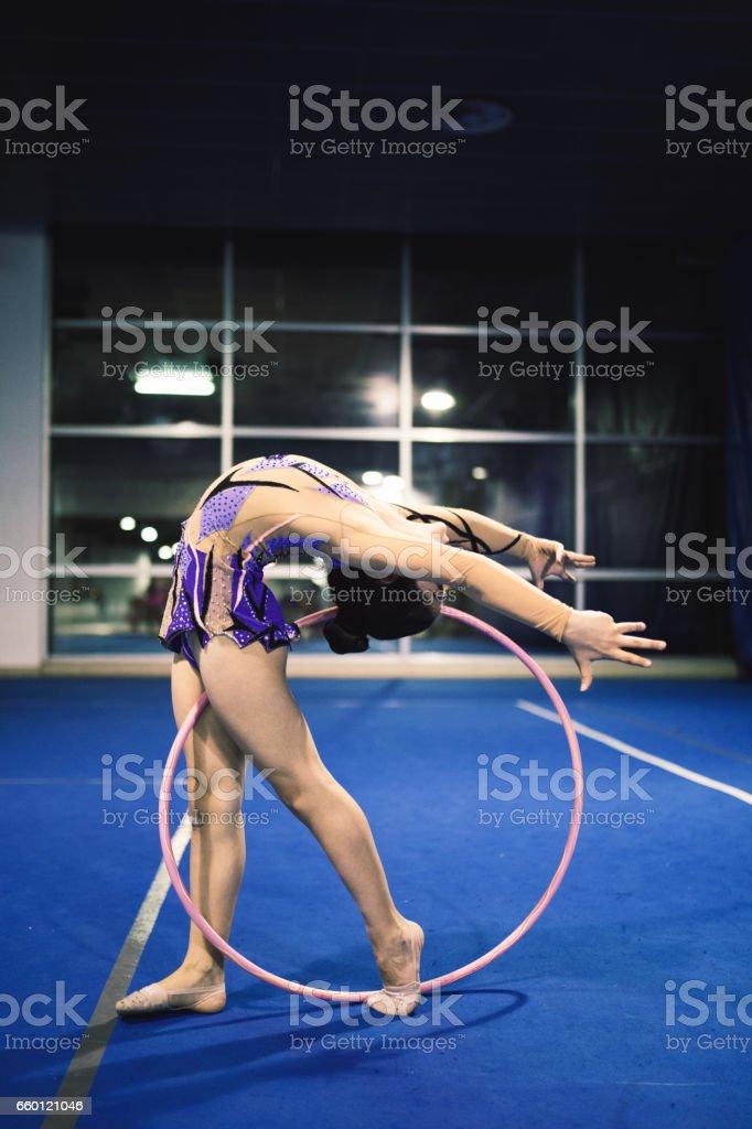 Girl is engaged in rhythmic gymnastics