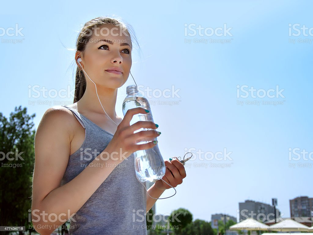 Girl is engaged in sports while listening to music stock photo