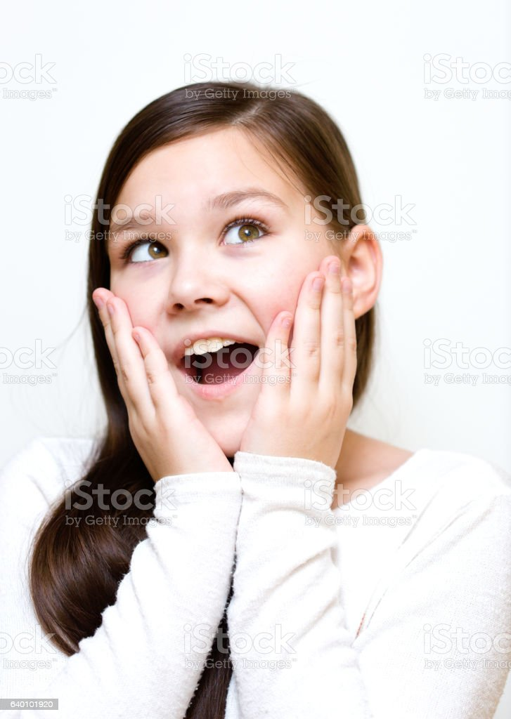 Girl is holding her face in astonishment stock photo