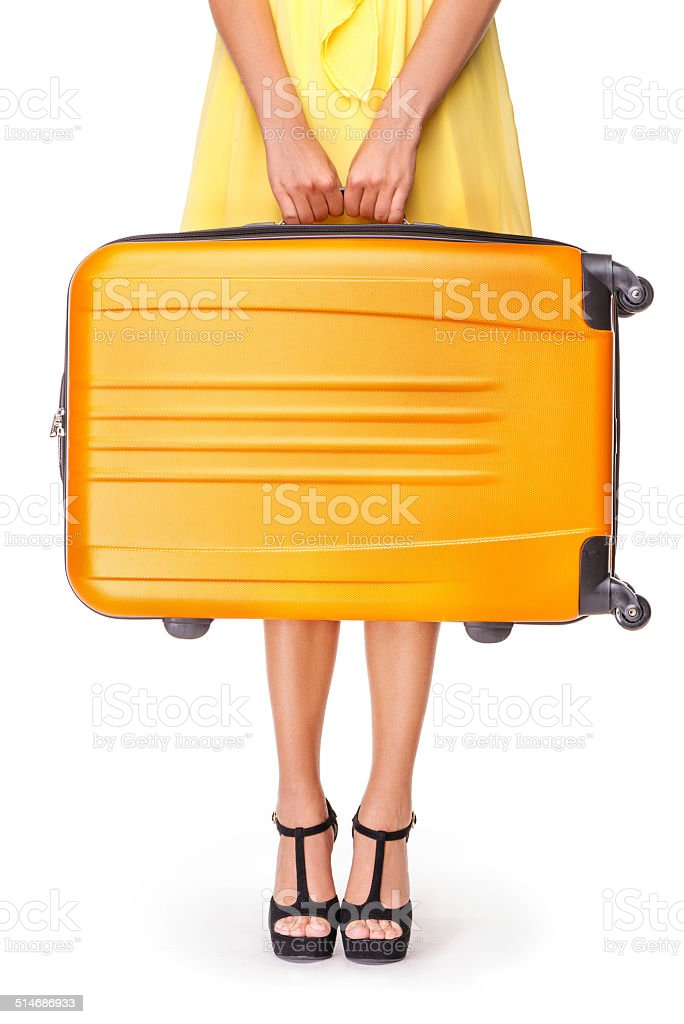 Girl is holding orange suitcase stock photo