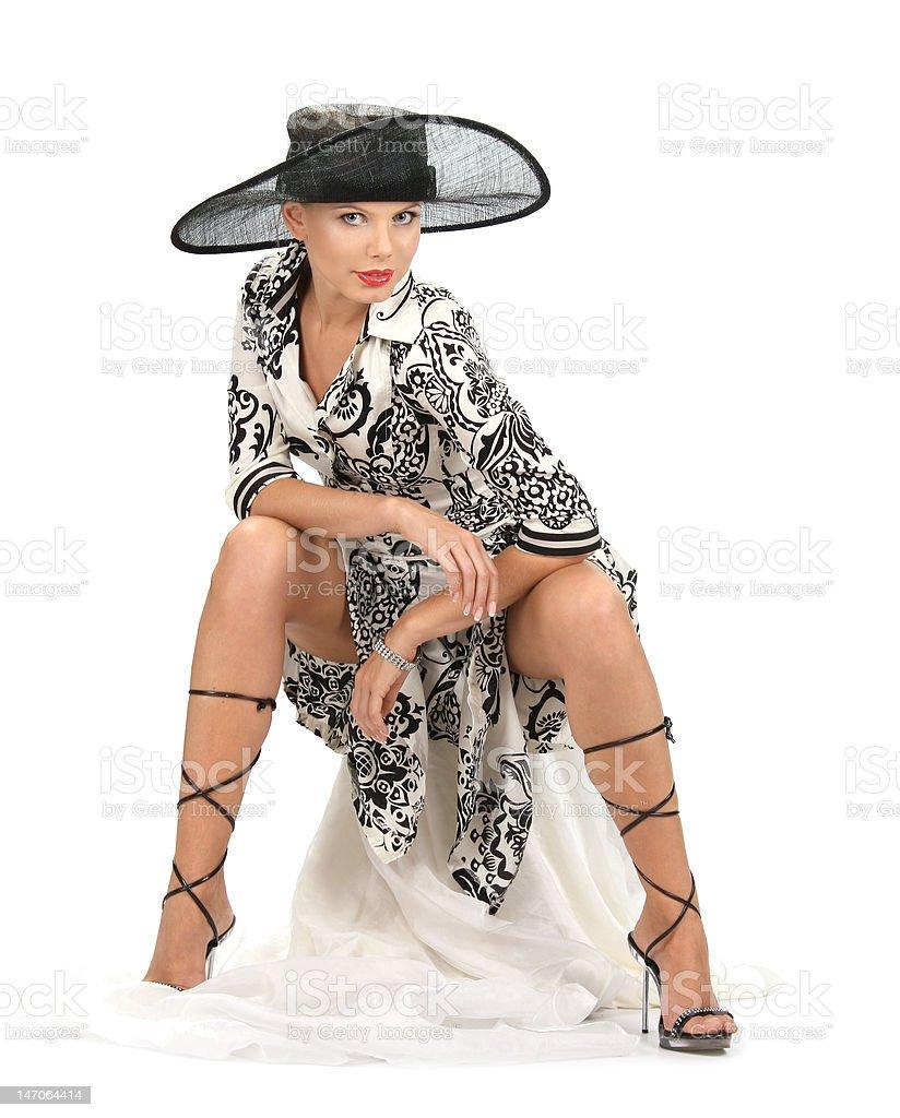 Menina em um chapéu em fundo branco foto de stock royalty-free