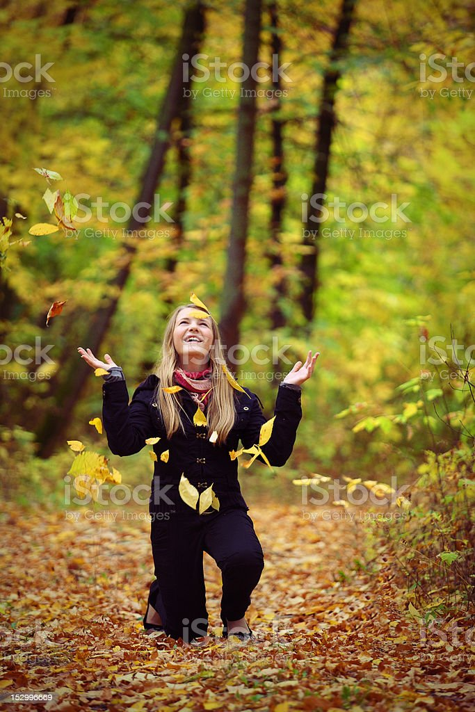 girl is in autumn park royalty-free stock photo