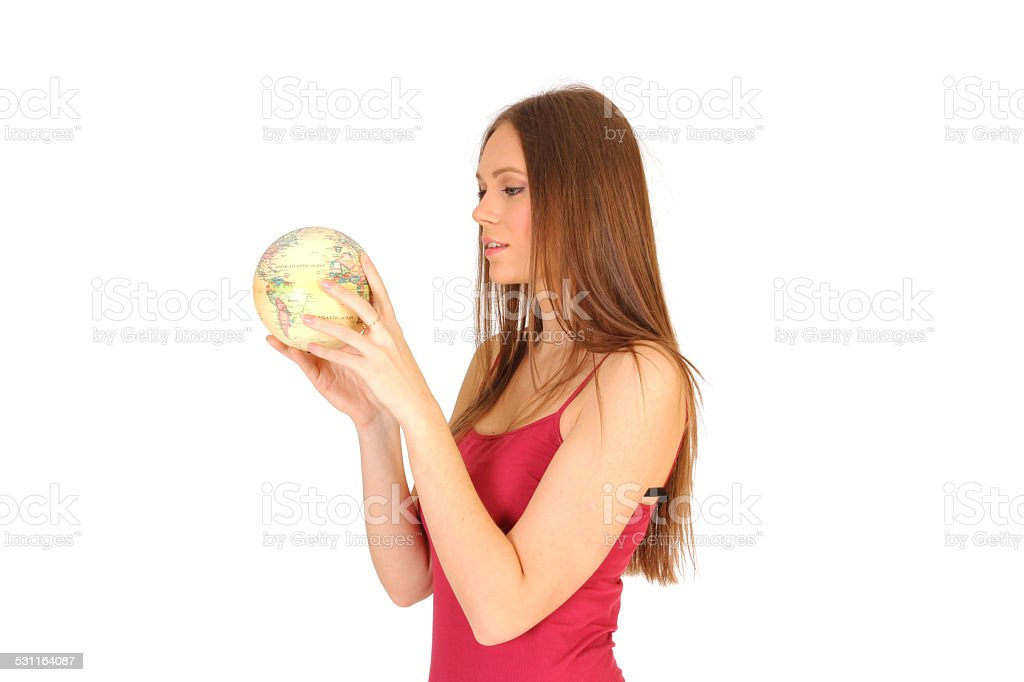 Girl is looking at the world globe stock photo