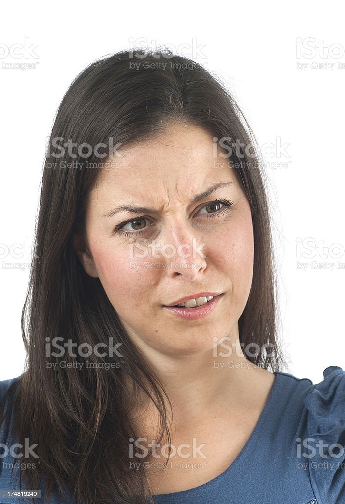 girl is looking doubtfully to the right stock photo