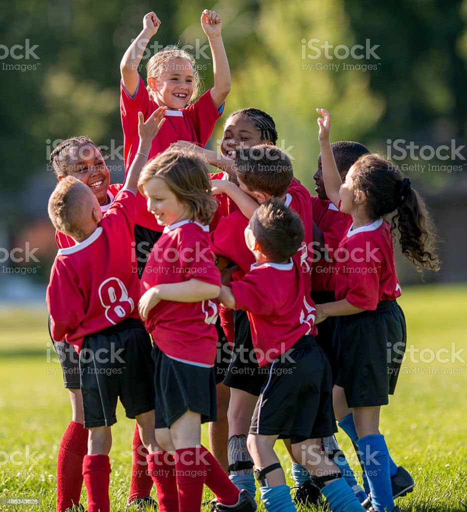 Girl is Raised Up by Teammates stock photo
