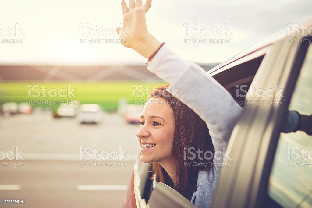 Girl is saying goodbye stock photo