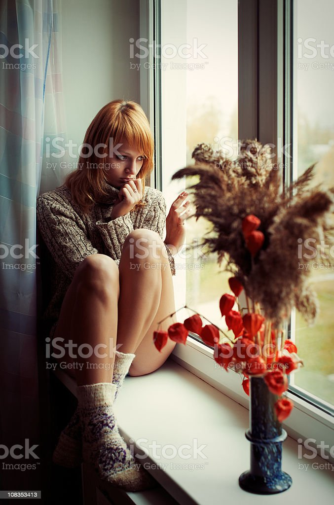 Girl is sitting on the window royalty-free stock photo