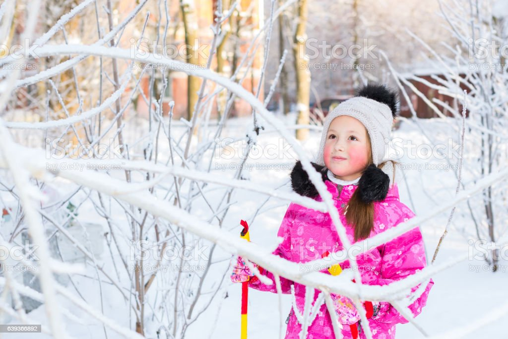 Girl is skiing in snow Park stock photo