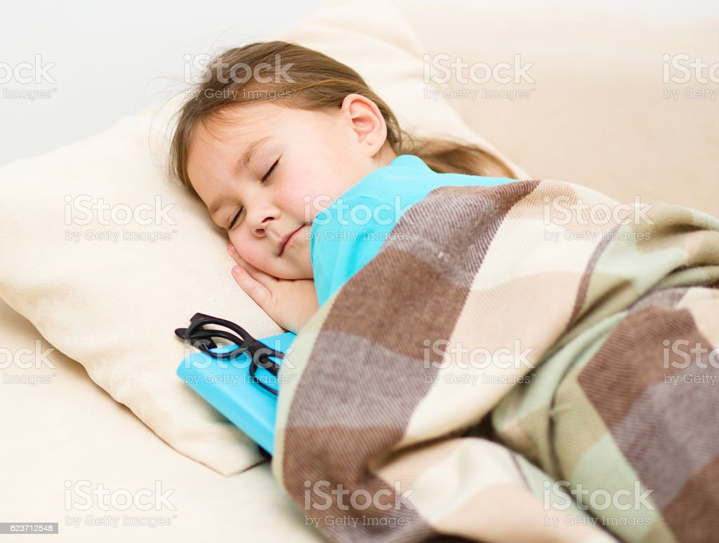 Girl is sleeping with her book and glasses stock photo
