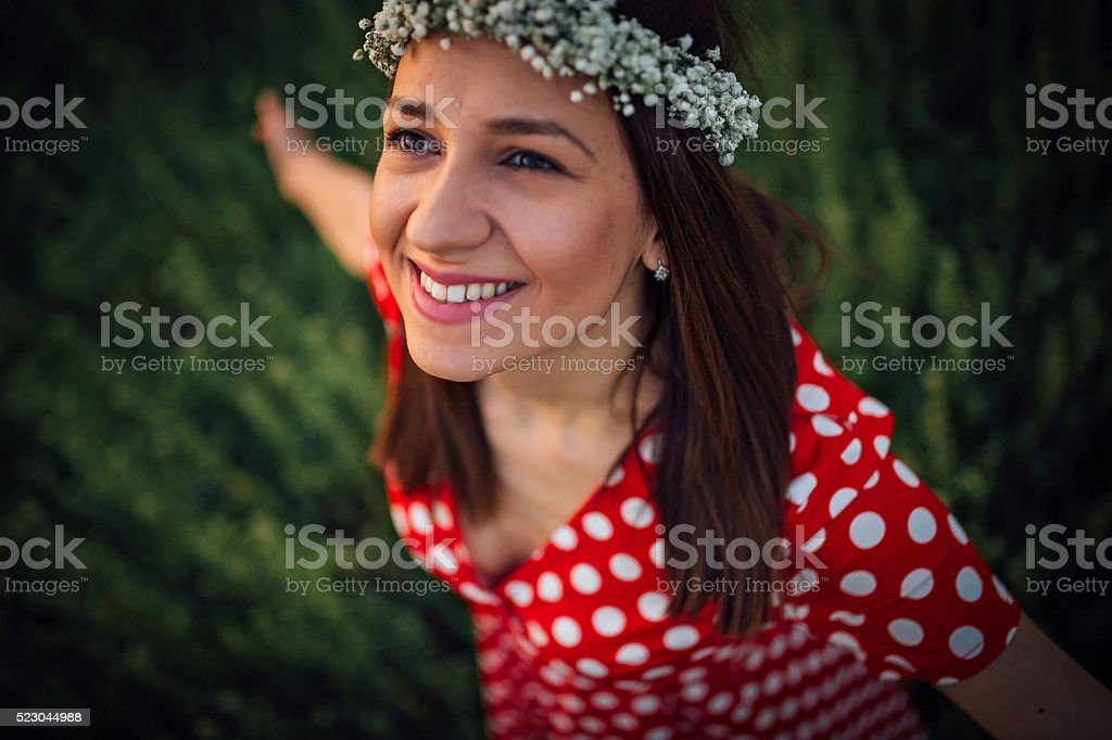 Girl is smiling with arms streched stock photo