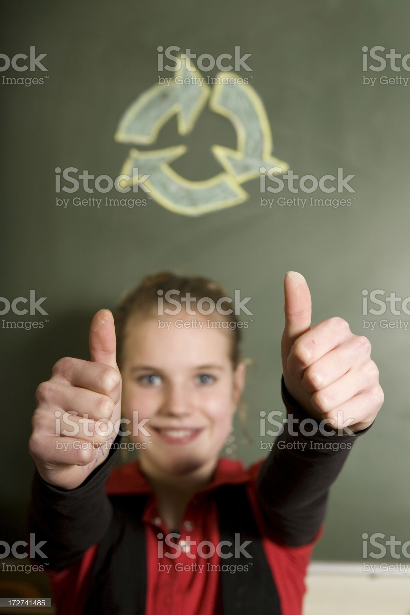 Girl is solving a problem on blackboard royalty-free stock photo
