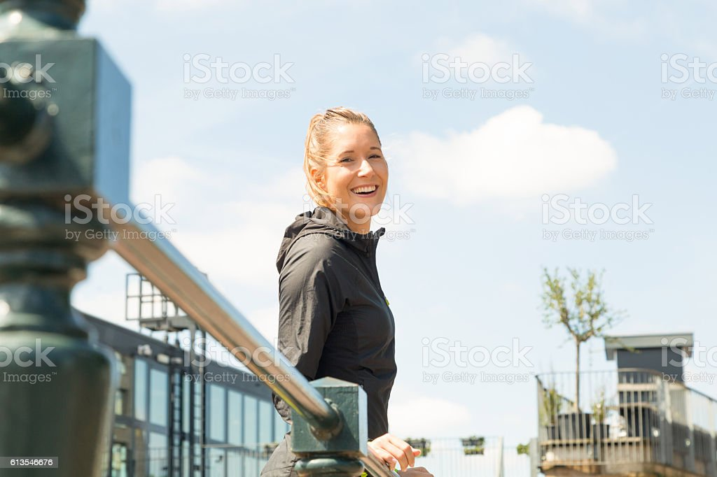 Girl is sports clothing posing and facing the camera stock photo