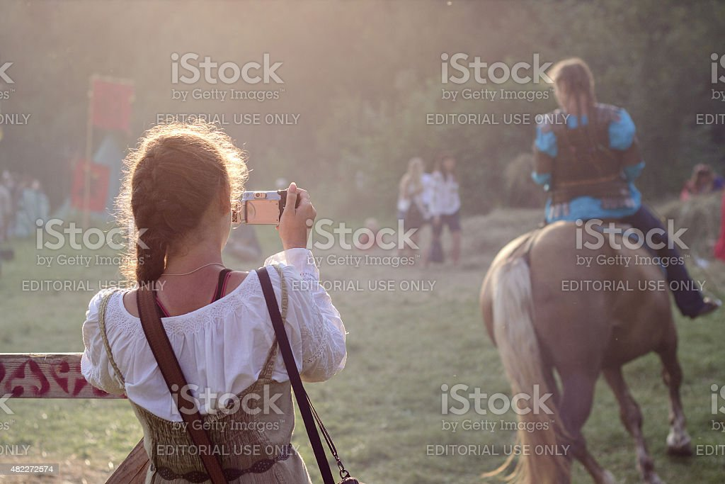 Girl is taking a photo, Tustan' festival in Urych, Ukraine stock photo