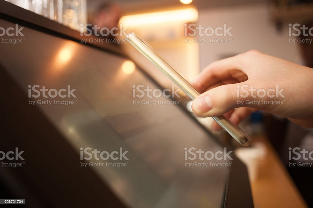 Girl is using a smarphone to pay stock photo