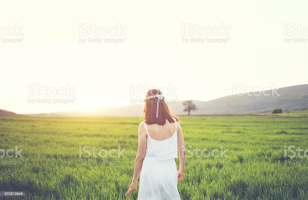 Girl is walking through nature stock photo