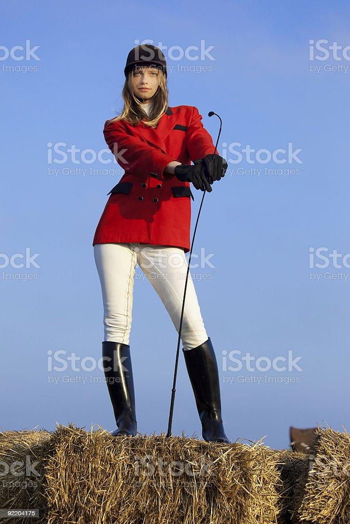 girl jockey / on a background of blue sky royalty-free stock photo
