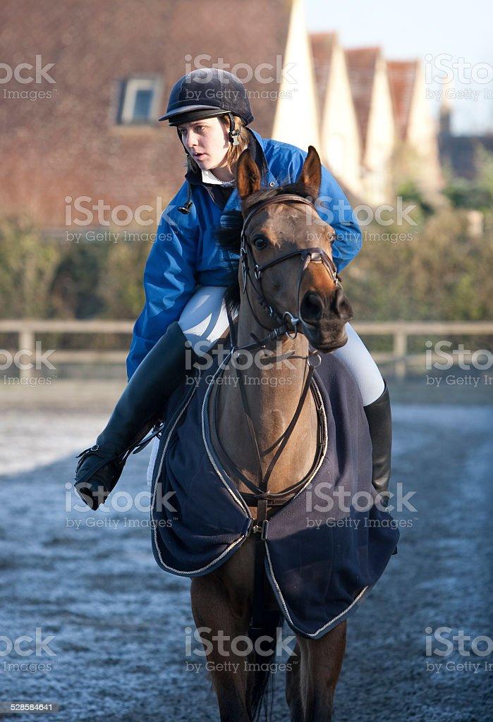 Girl Jockey warming up a Race Horse stock photo