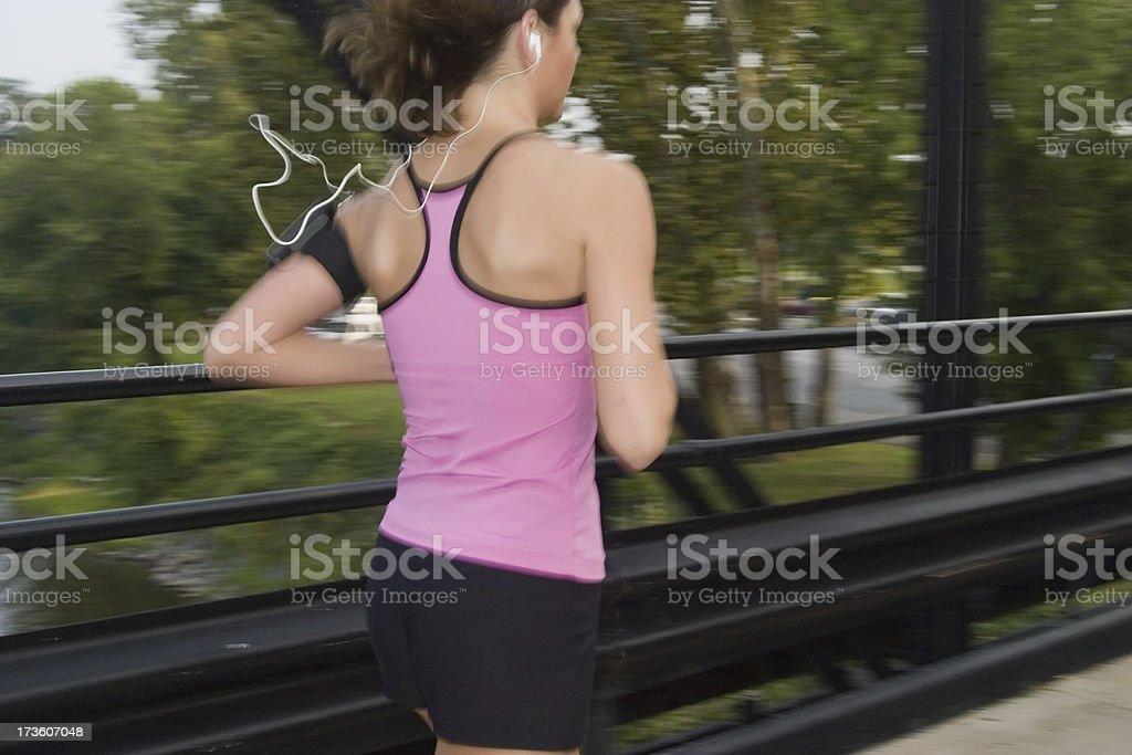 Girl Jogging on a bridge stock photo