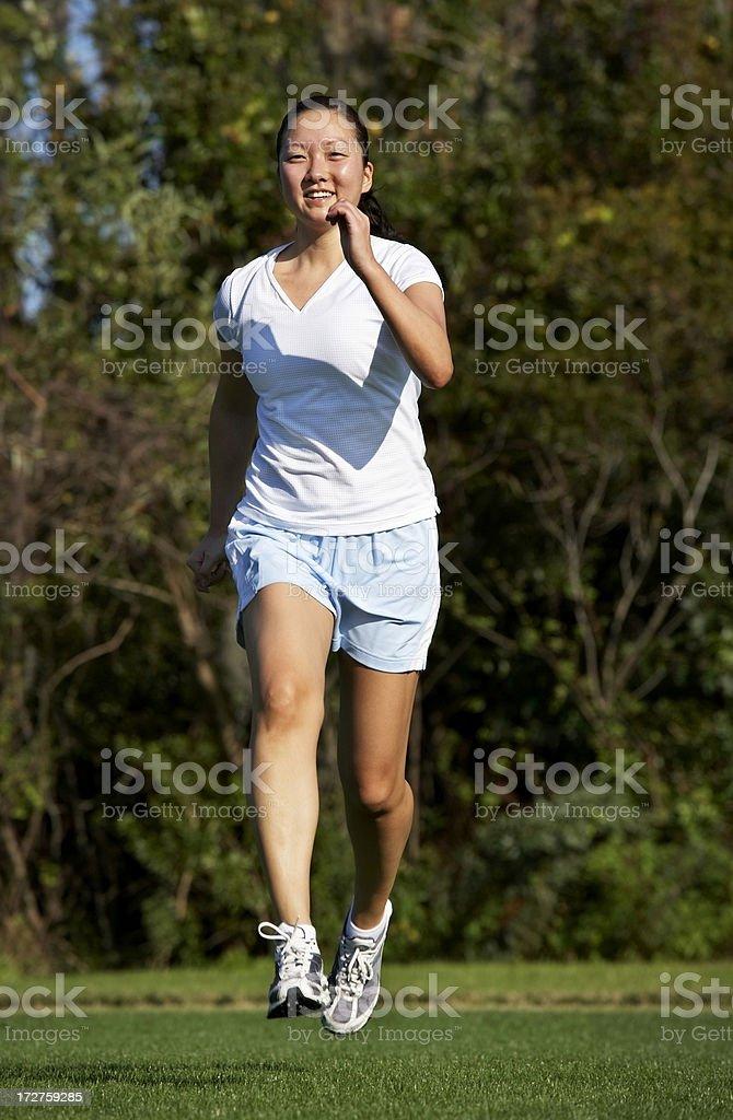 Girl jogging royalty-free stock photo