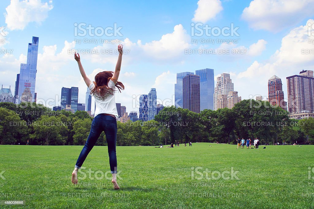 Girl jump in the Central Park of New York stock photo