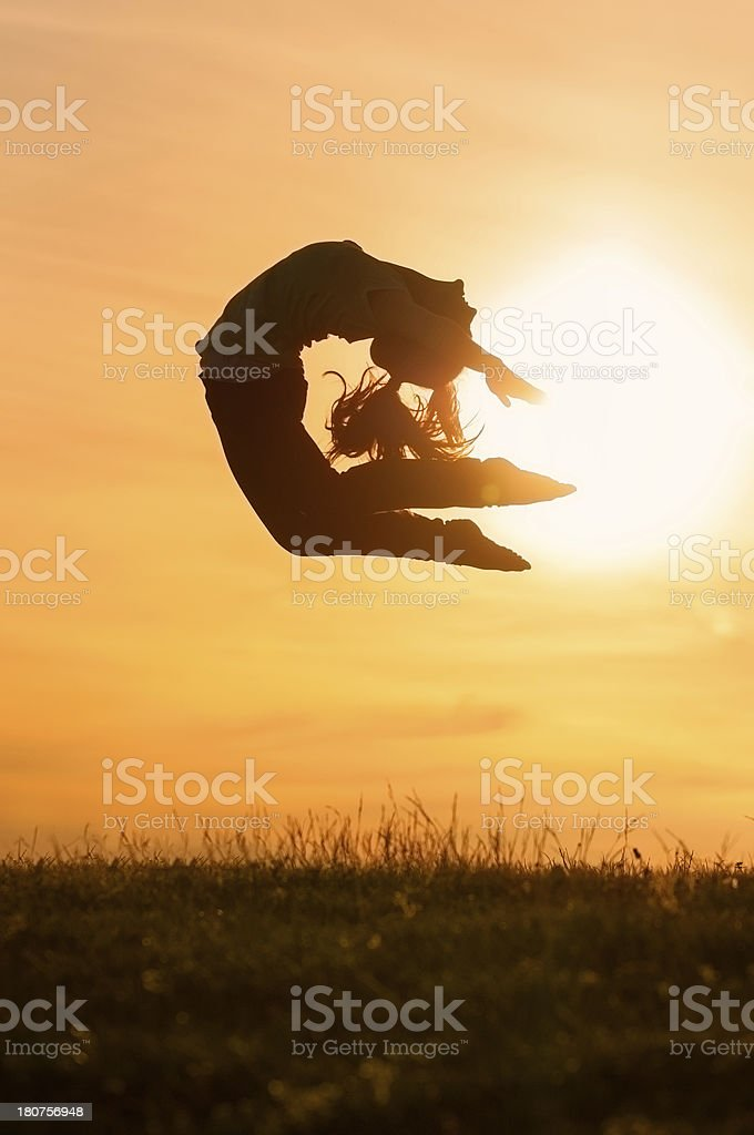 Girl Jumping in Front of the Sun royalty-free stock photo