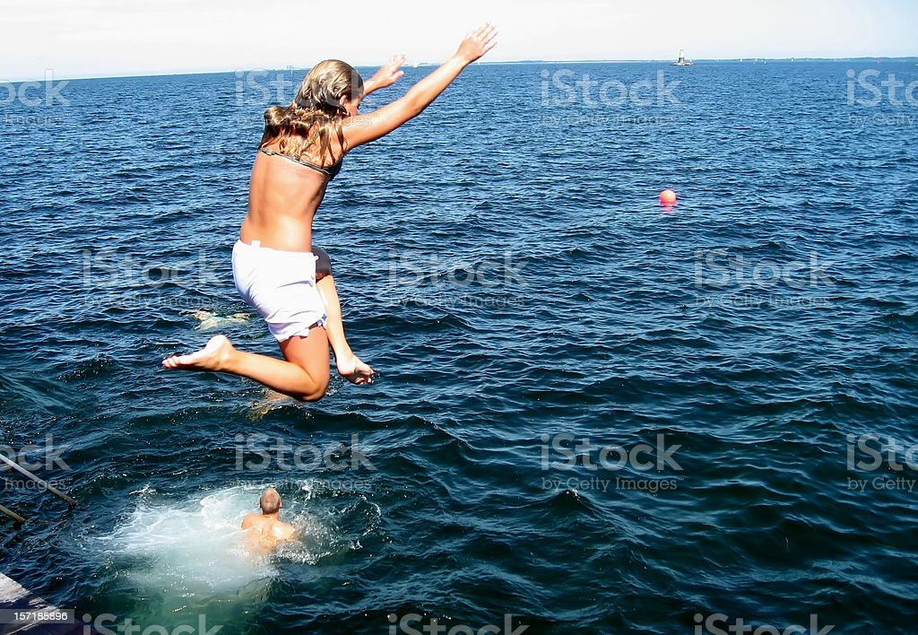 girl jumping into the sea royalty-free stock photo