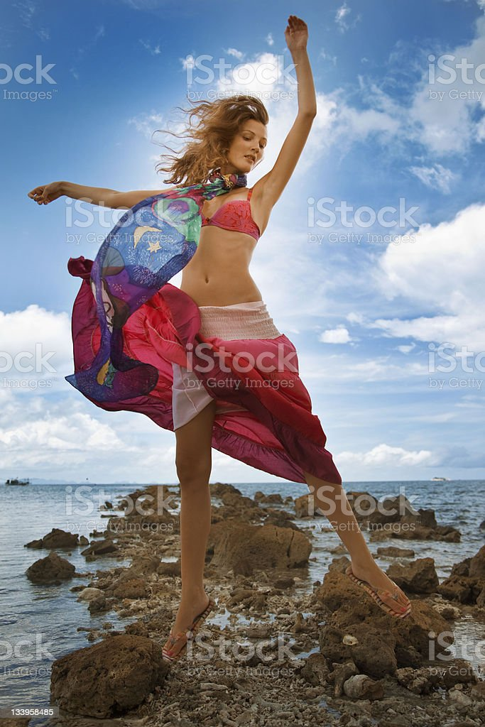 Girl jumping on beach royalty-free stock photo